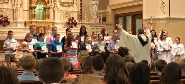 Sixth Graders Receiving their Bibles